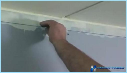 Boarded ceiling with his hands