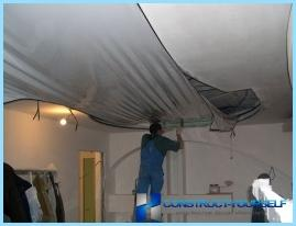 Repair stretch ceiling with his hands from the bay, cut