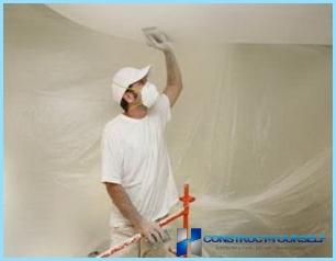 Whitewashing the ceiling with his hands