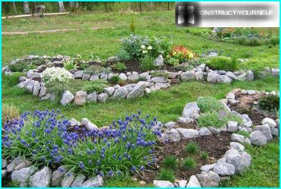 The stones serve as a support for the soil in raised beds rockeries