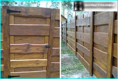 The gate in a wooden fence