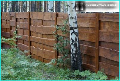Wooden fence in a wooded area