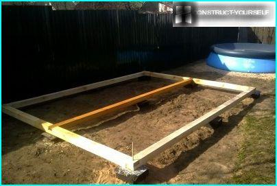 Bottom rail, laid on the foundation pillars