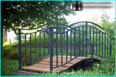 Humpback metal bridge with wooden flooring