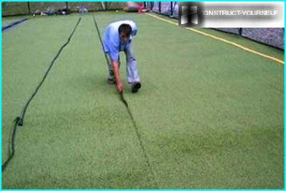 Laying artificial turf