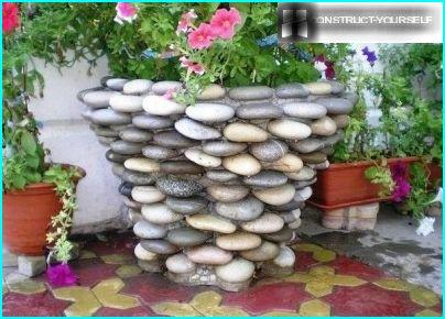 Flower pot made of pebbles