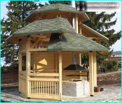 A wooden gazebo with barbecue