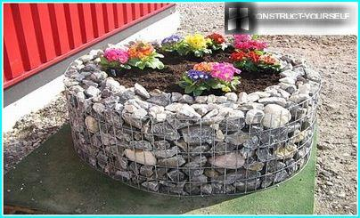 Gabion cylindrical shape as flowerbeds