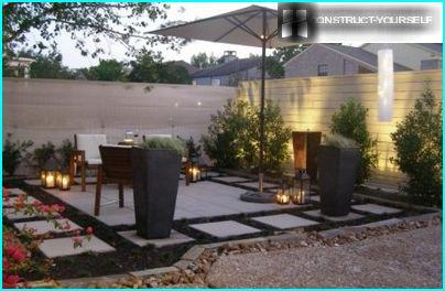 The outdoor area features simple geometric shapes