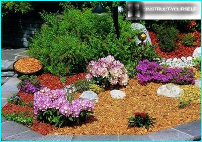 A neat flower garden, decorated with wood dumping