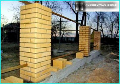 A fence made of brick on strip foundations