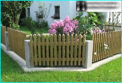 Wooden fence - beautiful frame and reliable protection