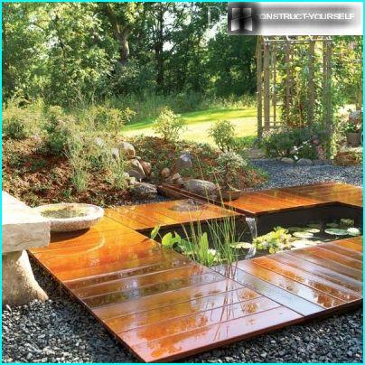The rectangular pond with decking board