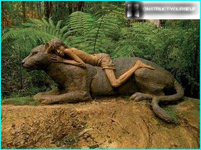 Mowgli astride Bagira