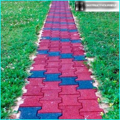 Garden path of bright rubber tiles in two colors