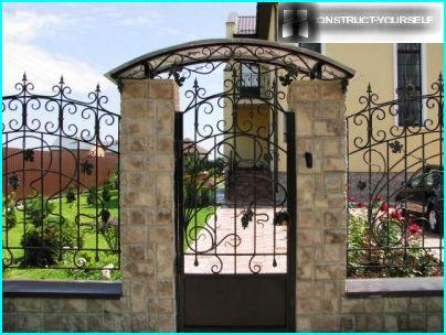 Wrought iron gate framed by stone or brickwork