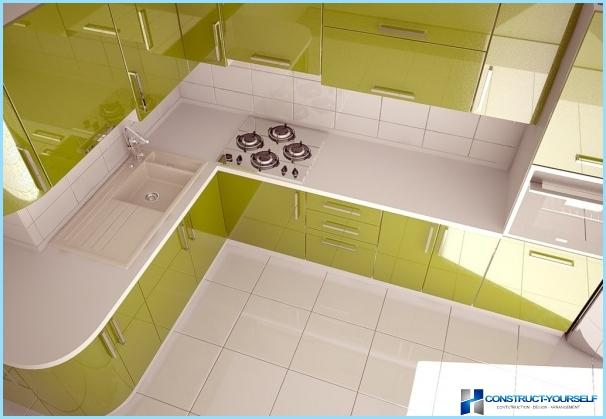 Kitchen in green and white tones
