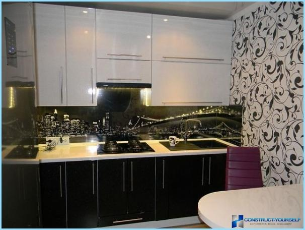 Design black and white kitchen in the apartment