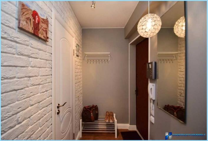 The interior is a small hallway with his hands