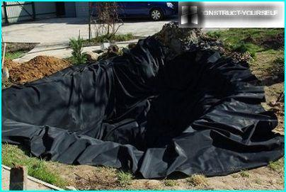 The pit, covered with butyl rubber film