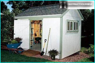 Covered with siding garden house