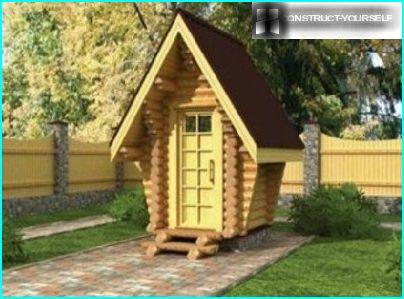 Country toilet in the form of a fairytale wooden house