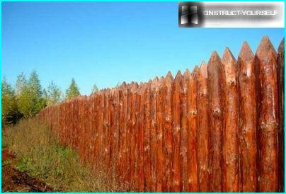 A high fence made of palisade – protection phase