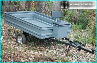 A small trailer with drop sides