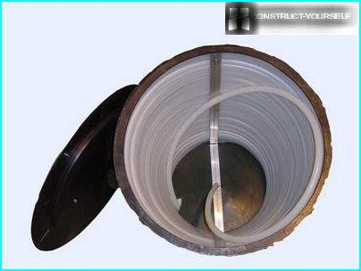 A barrel with a hose