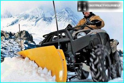 ATV with mounted snow plow equipment