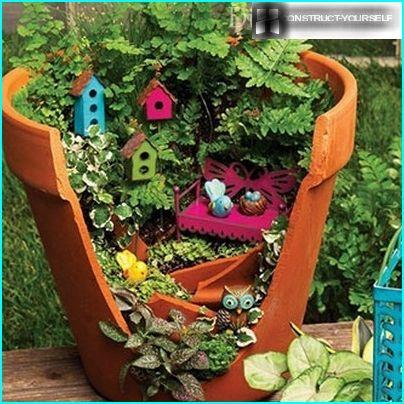 Miniature garden in a broken pot